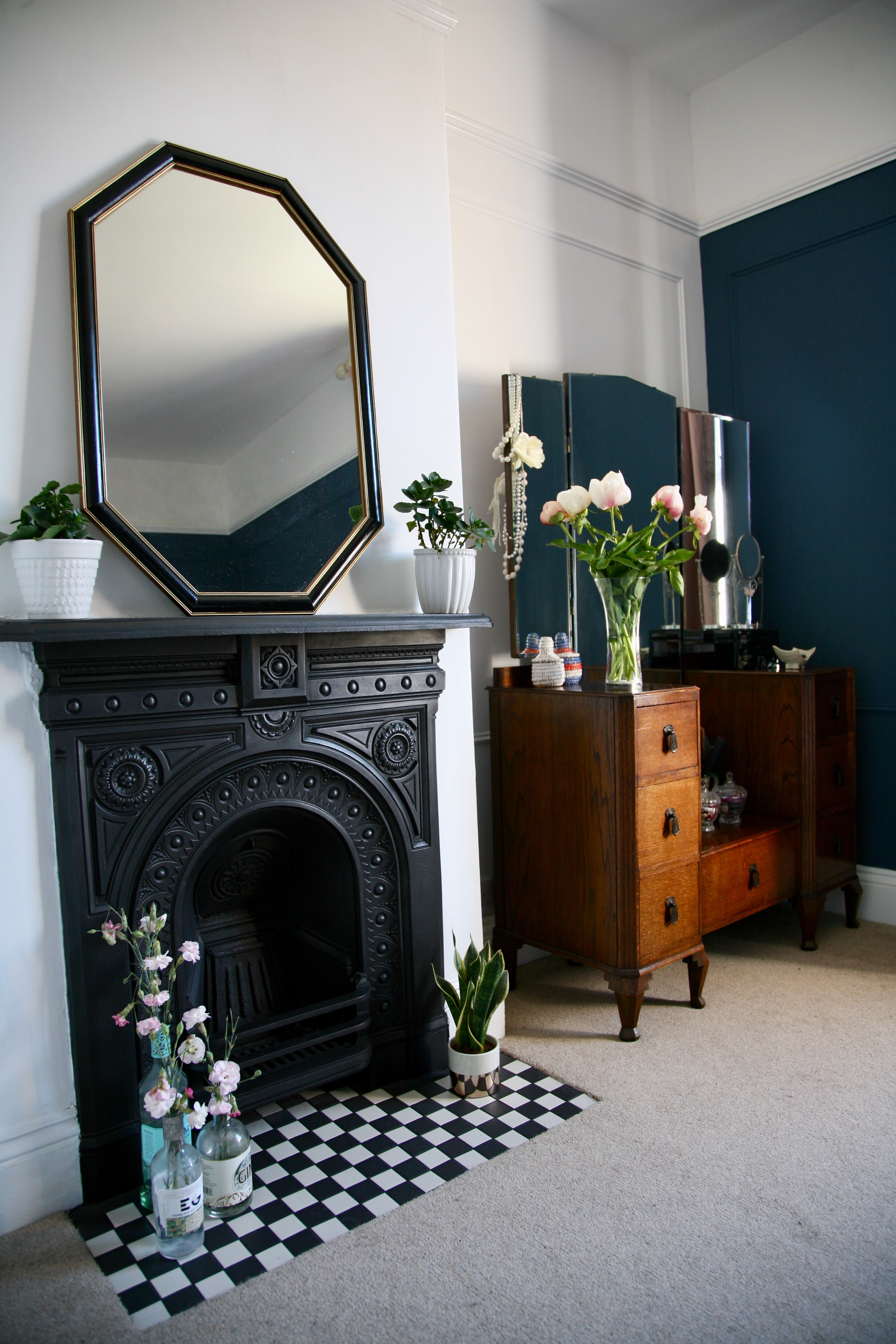 Cast iron fireplace with monochrome tiles in the hearth