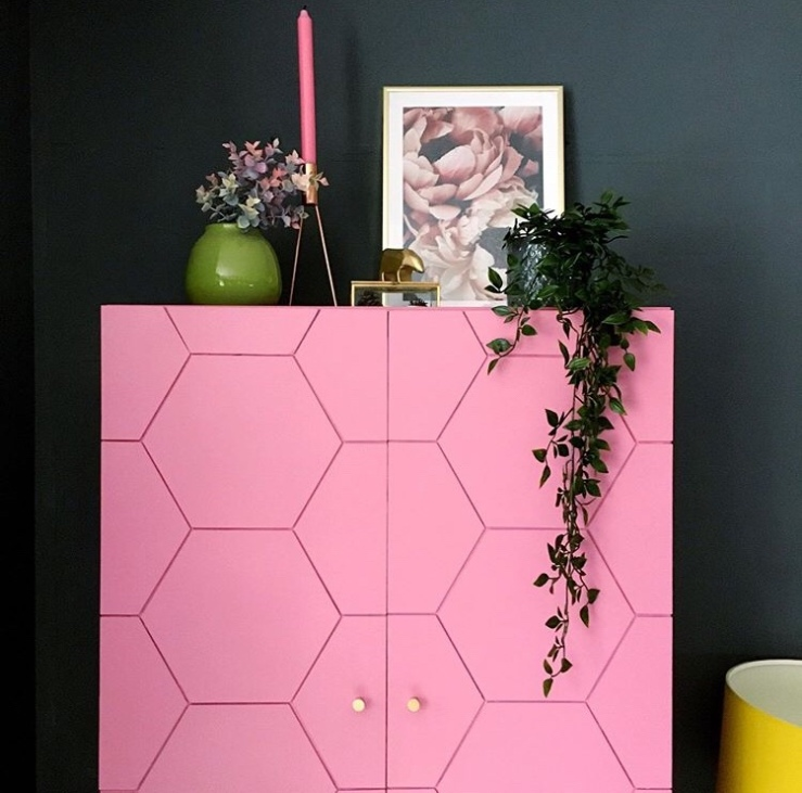Ikea unit has been up cycled and new doors with a hexagonal design have been painted pink.