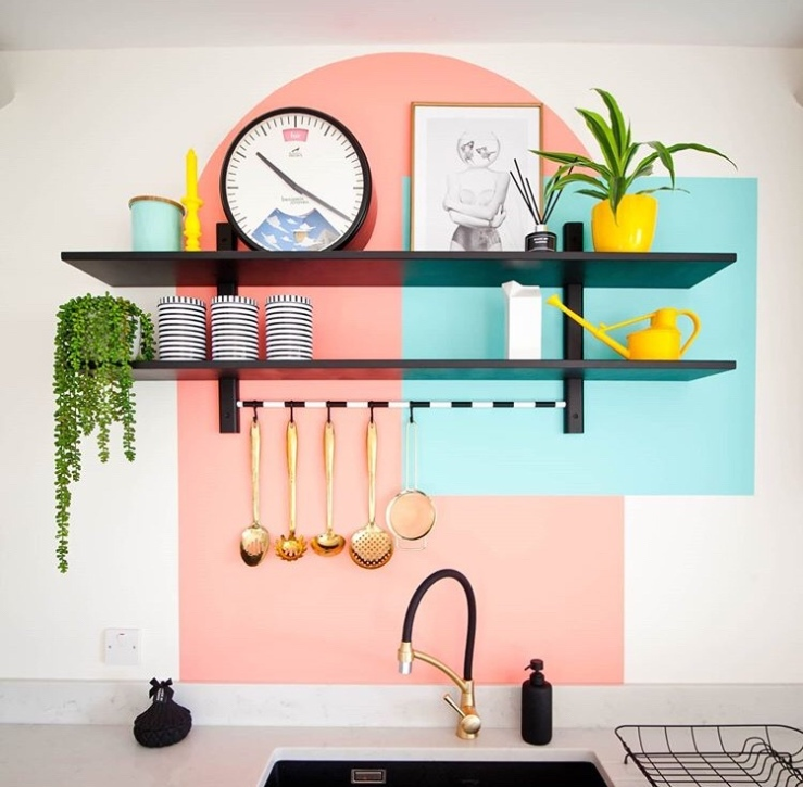 Blocks of colour using a coral arch and a turquoise square above a kitchen sink.