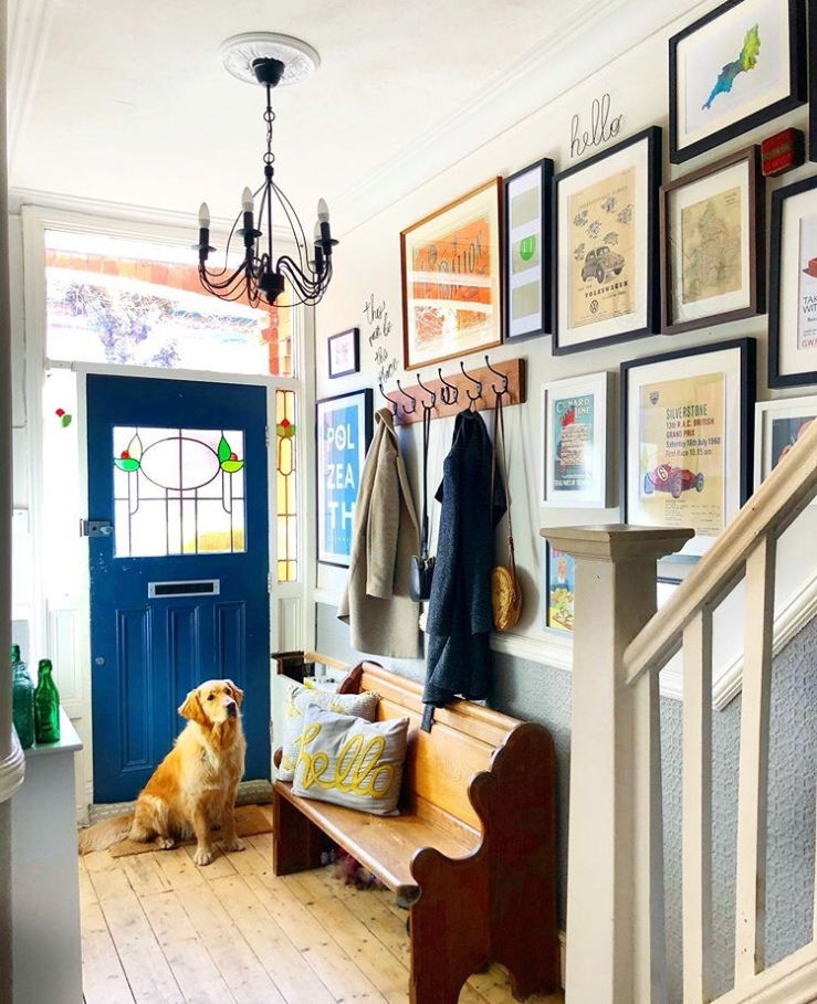 A gallery wall has been created in the hallway using artwork sources from eBay and small businesses.  The pictures are on the wall going up the stairs.