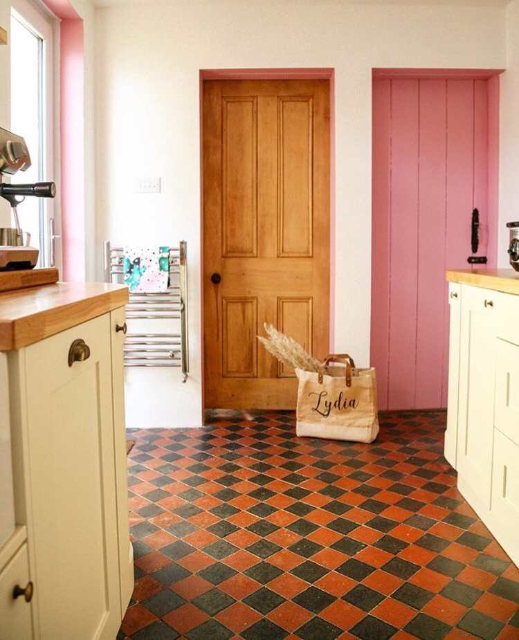 A cellar door and window and door reveals have been painted pink to create a feature.