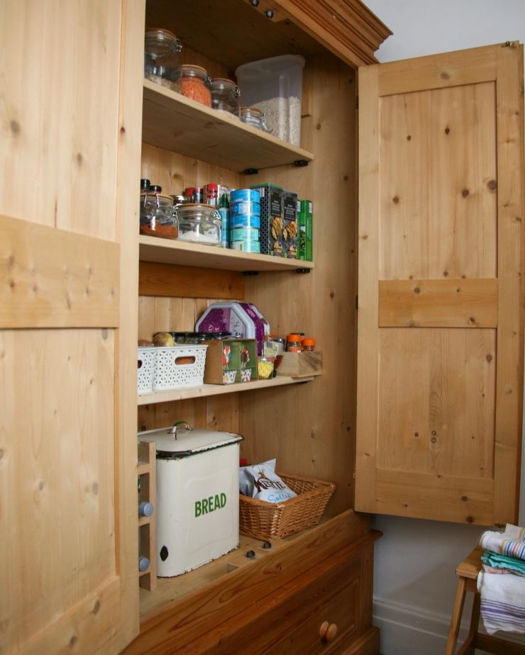 Wardrobe converted into a larder cupboard