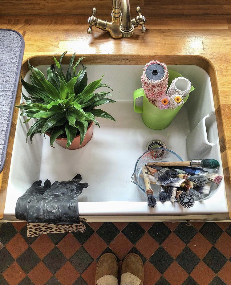 10 Painting Tips for Beginners (A Belfast sink full of brushes and rollers which need to be cleaned)