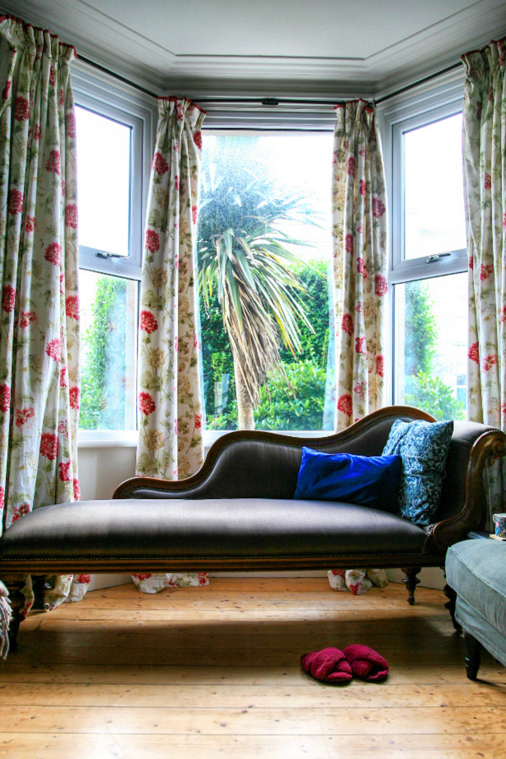 Buying Preloved or Vintage 2 - A chaise longue in a bay window with cushions.